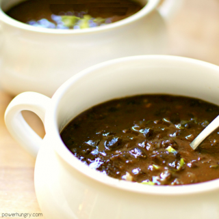 two white bowls filled with 3-ingredient black bean soup