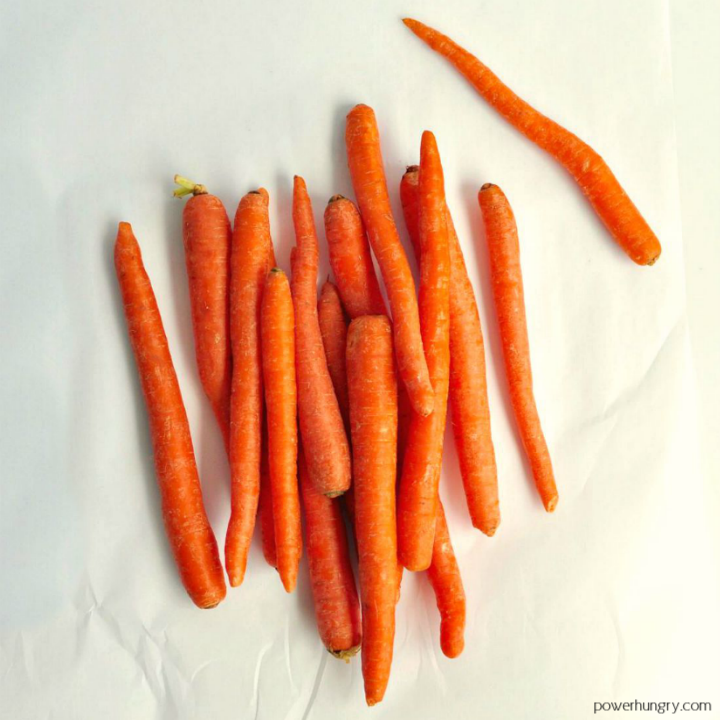 overhead shot of carrots on a piece of white parchment paper