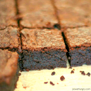 vegan sweet potato brownies cut into squares on a white cutting board