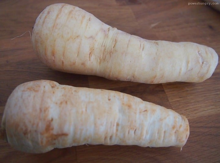 2 large parsnips on a cutting board