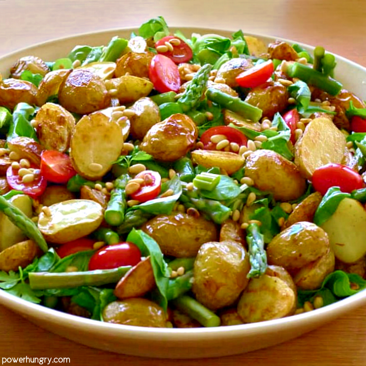 roasted potato asparagus salad in a serving bowl