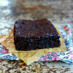 healthy vegan almond flour brownie on a parchment lined floral napkin