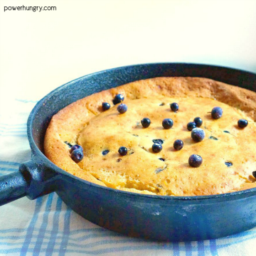 cast iron skillet filled with vegan and gluten-free Dutch baby pancake
