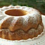 Gluten-Free Vegan Vanilla Bundt Cake on a Crystal Platter, dusted with Powdered Sugar