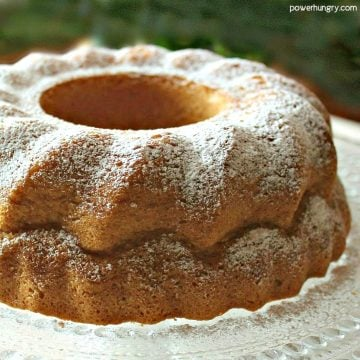 Gluten-Free Vegan Vanilla Bundt Cake on a Crystal Platter, dusted with Powdered Sugar