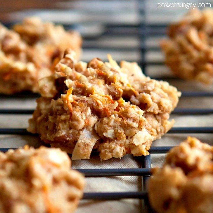 close up of a healthy carrot cake breakfast cookie on a black metal cooling rack