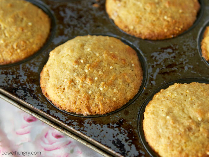 banana millet muffins in a metal muffin tin