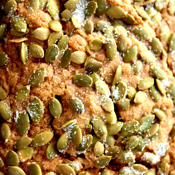 close up of the top of vegan pumpkin bread madewith gluten-free flour and topped with pepitas