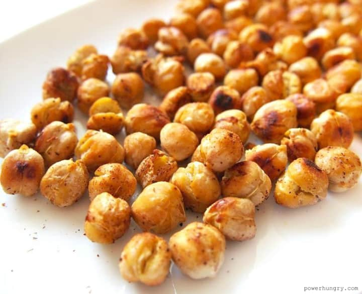 close up of oil-free crispy roasted chickpeas on a white plate