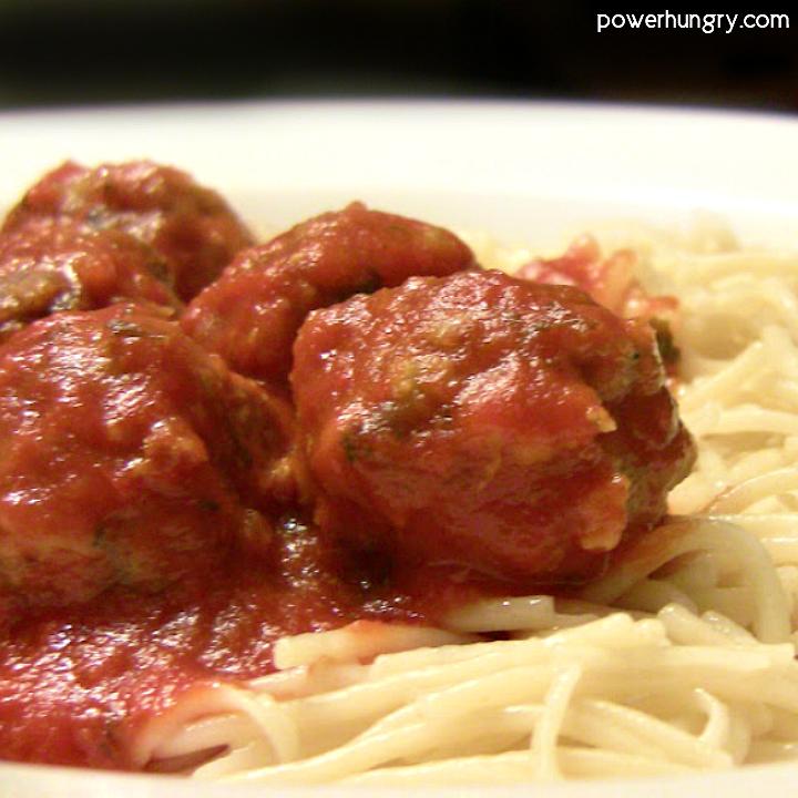 plate of vegan tvp meatballs covered in marinara sauce