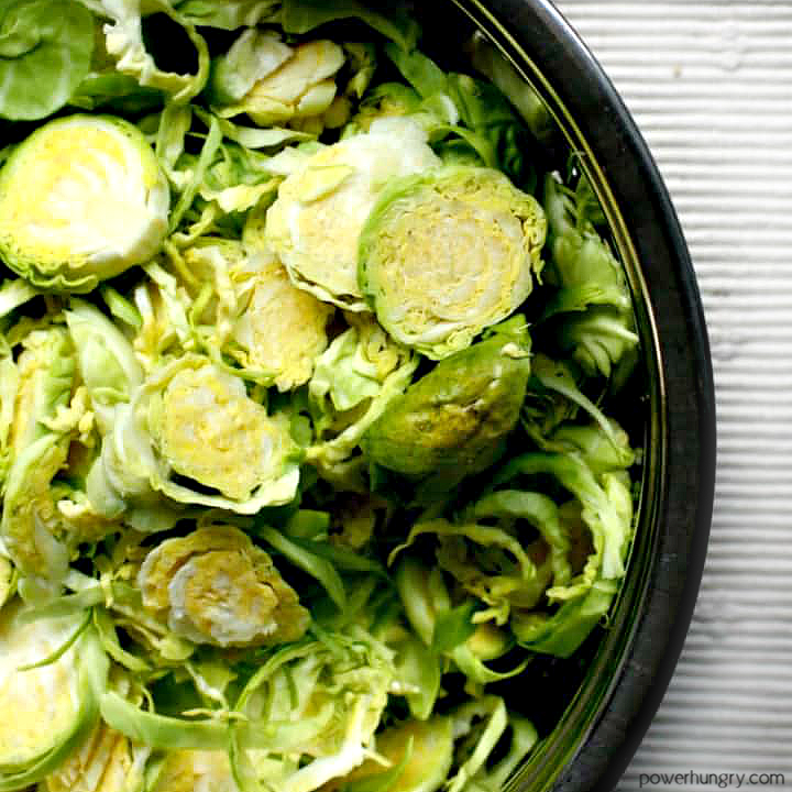shredded brussels sprouts in a bowl atop a white linen napkin