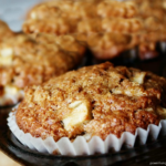close-up of apple cinnamon coconut flour muffins in a muffins tin