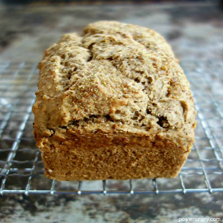 a loaf of quinoa flour and almond flour soda bread, cooling on a wire cooling rack