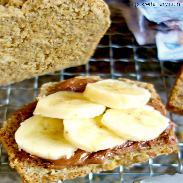aslice of quinoa and almond soda bread topped with chocolate hazelnut spread and banana slices