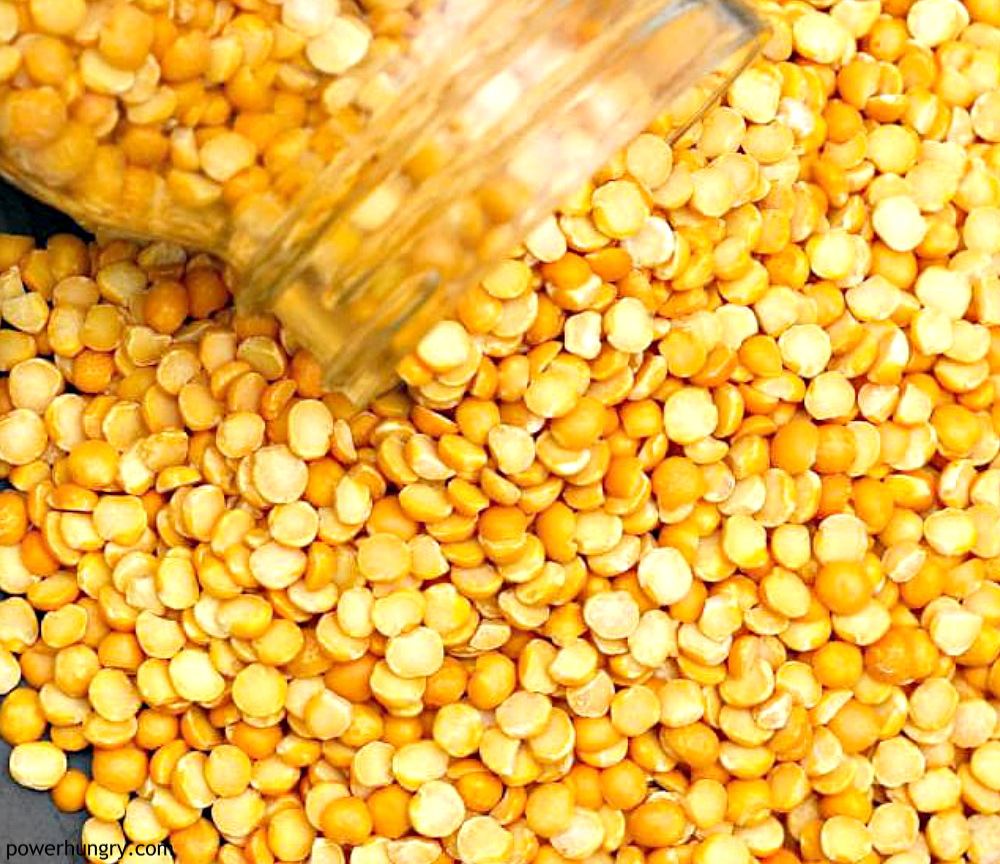 yellow split peas spilling out of a glass jar
