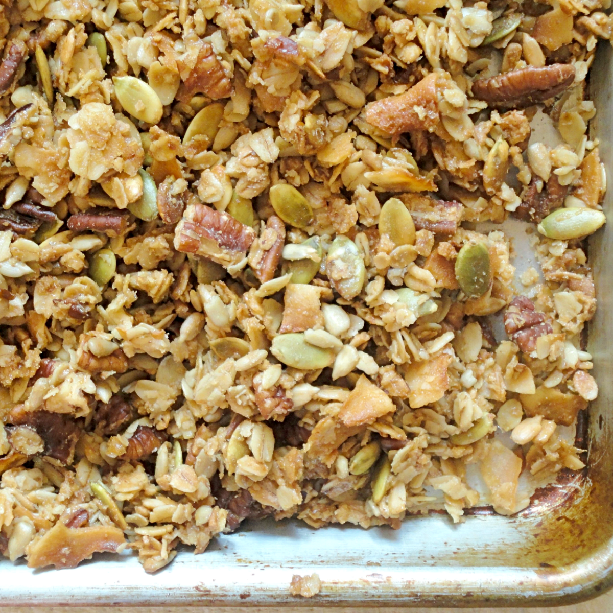 sheet pan covered with high protein banana bread granola