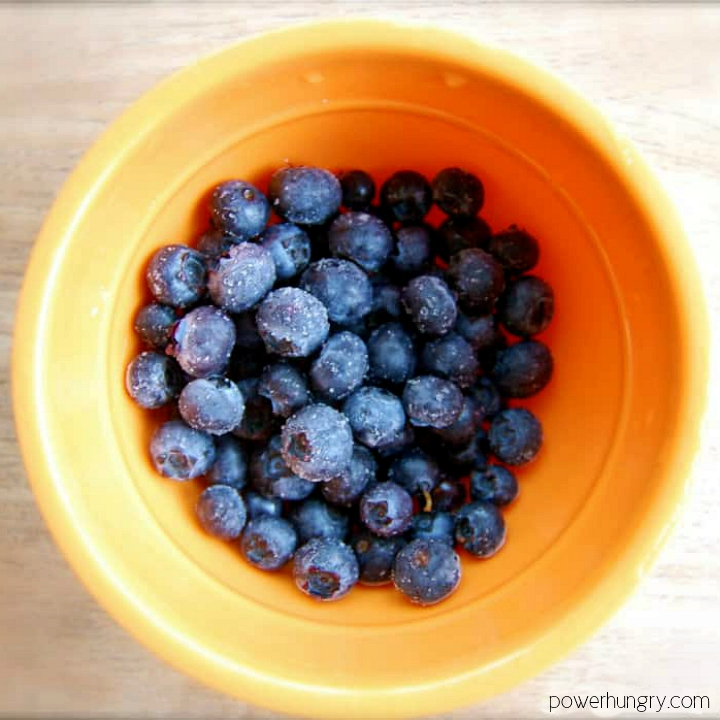 small yellow bowl filled with fresh blueberries