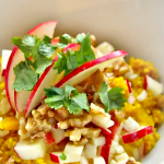 curried millet in a white bowl with raw apple relish