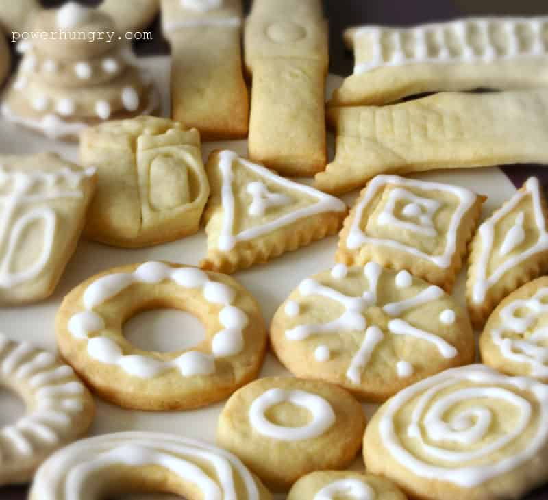 maple syrup-sweetened almond flour cut out cookies on a white plate
