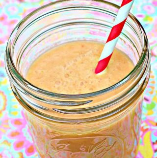 cantaloupe straberry smoothie in a glass