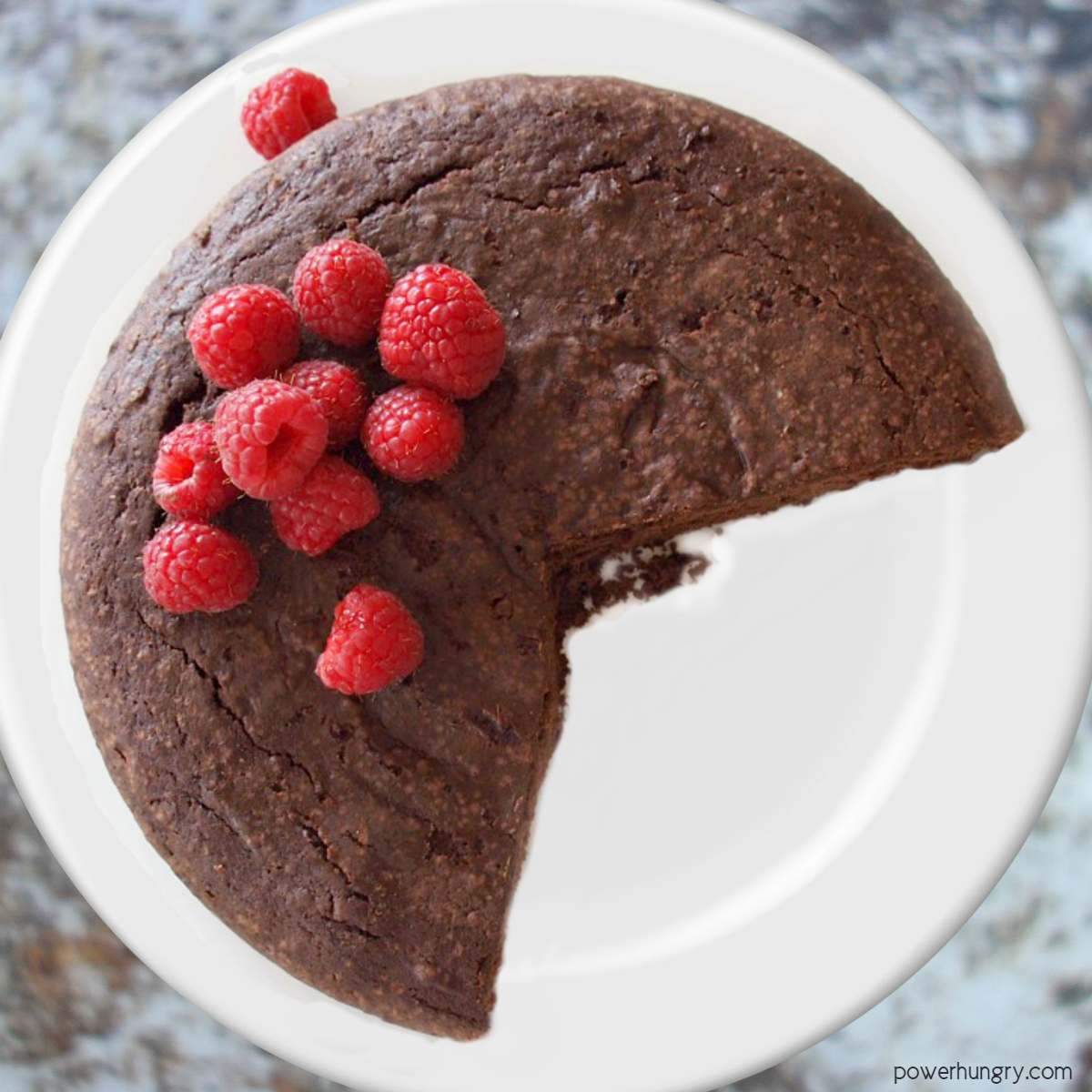 vegan coconut flour chocolate cake on a white plate
