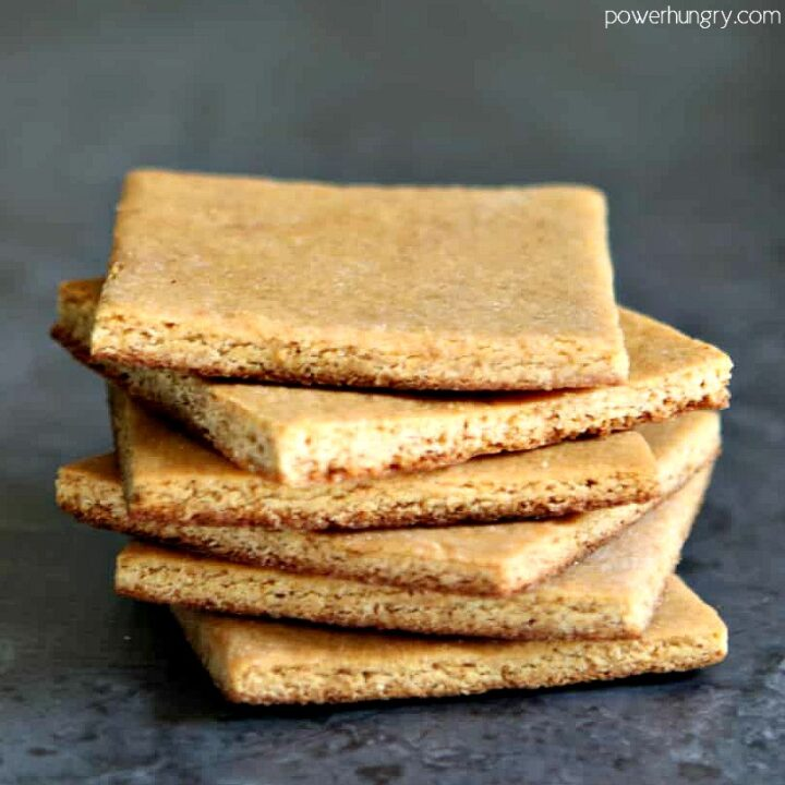 a stack of vegan almond flour graham crackers with a grey background