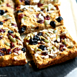 coconut flour and flax breakfast bars, cut into squares on a slate cutting board