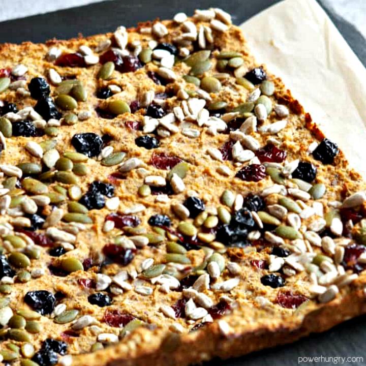 grai-free coconut flour breakfast bars, uncut, on a slate cutting board