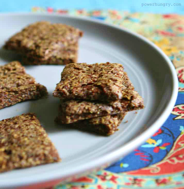 teff crackers on a grey pate atop a colorful napkin