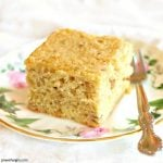 a square of vegan chickpea flour banana cake on a floral china plate