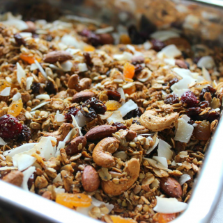 buckwheat granola with coconut and fruit on a baking sheet