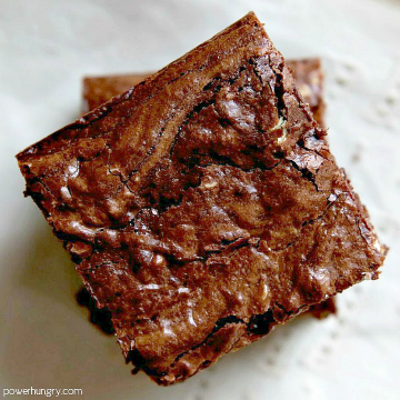 overhead shot of vegan coconut flour brownies on a white cloth napkin