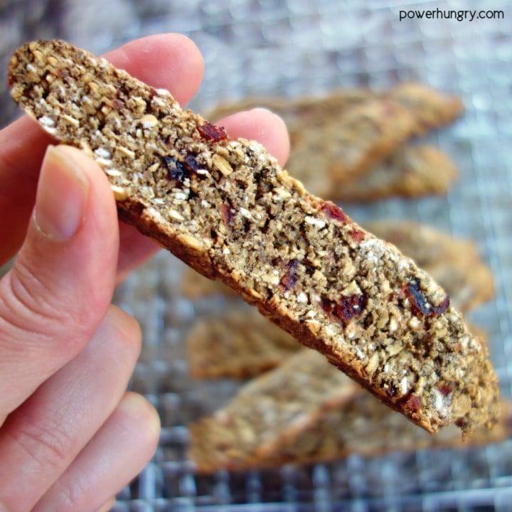 Vegan, flourless oat biscotti being held in hand