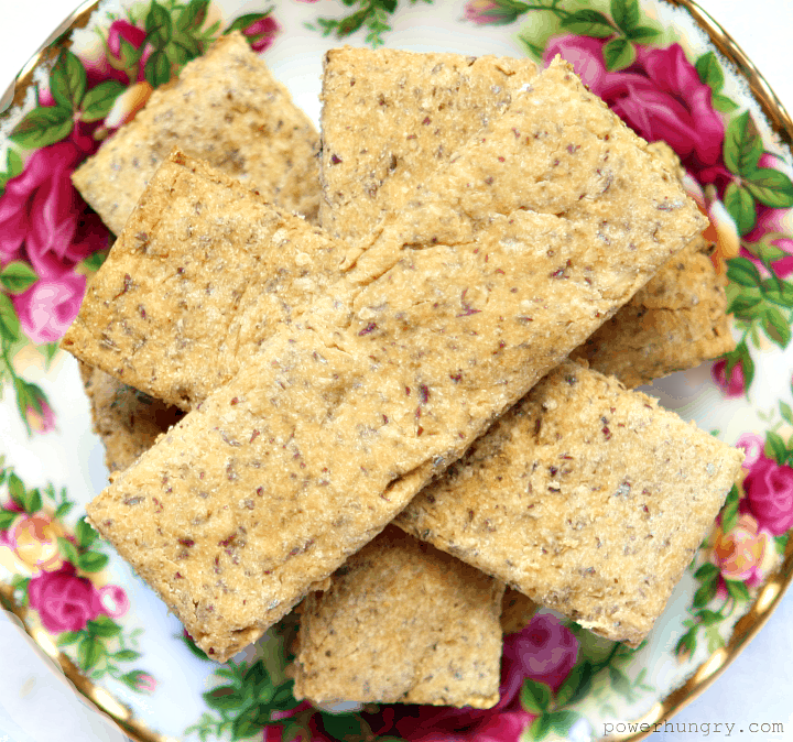 almond oat chickpea flour crackers on a floral china plate