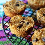 apple raisin millet muffins on a black cooling rack