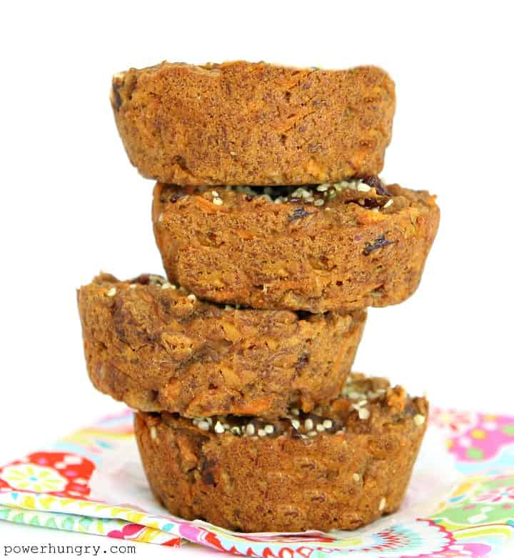 A stack of 4 vegan carrot cake breakfast cookies atop a colorful napkin.