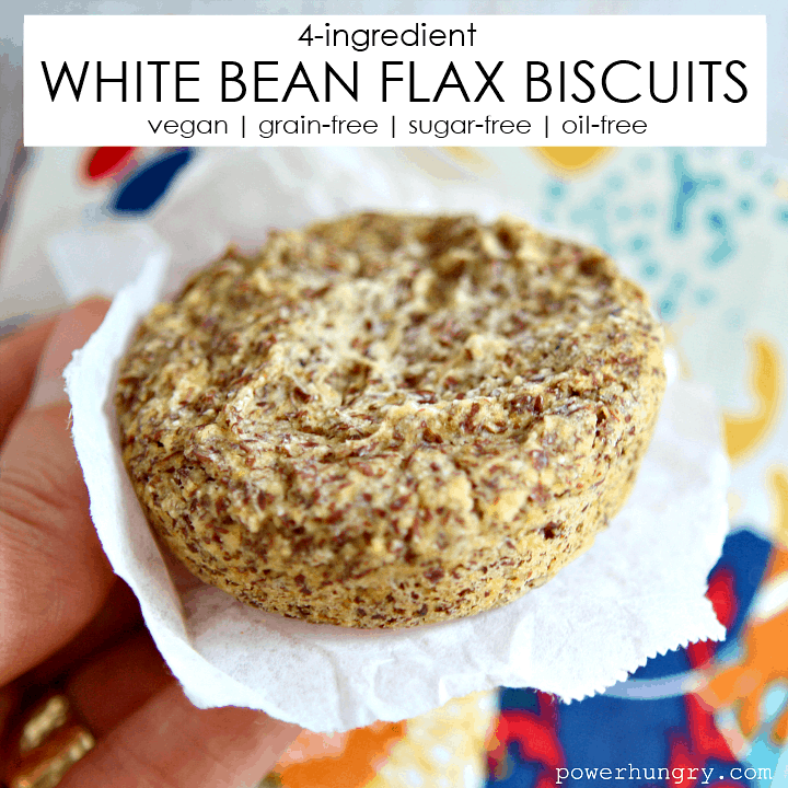 A white bean flax biscuit being held on a piece of parchment paper