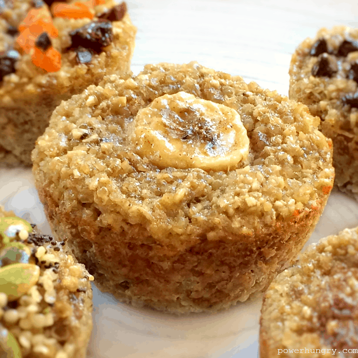 close-up of a vegan, oil-free, 3-ingredient banana quinoa muffin on a white plate with other muffins alongside