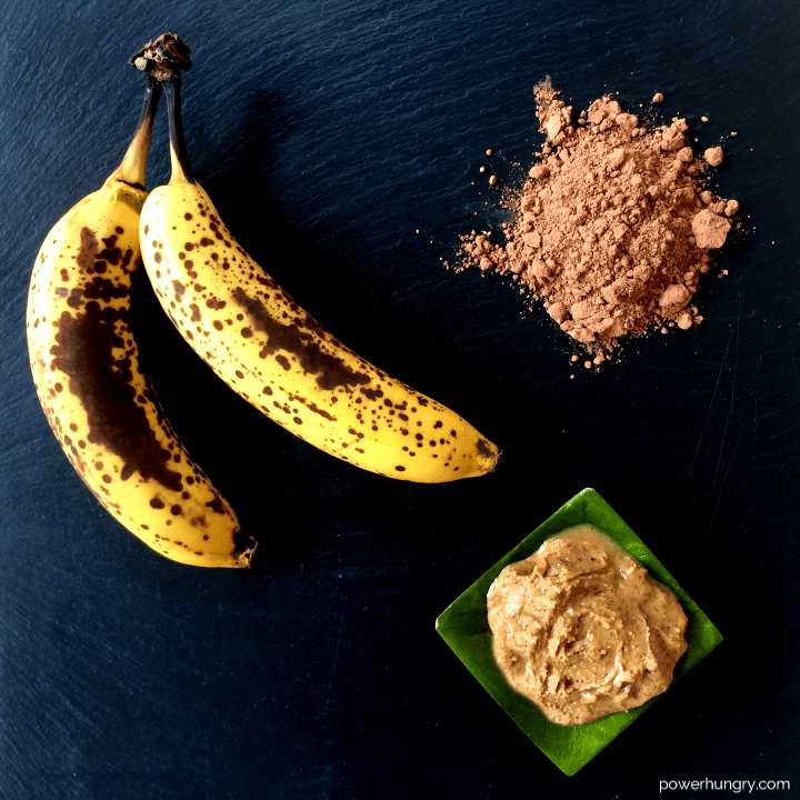 the three ingredients for banana fudge brownies, all on a piece of slate