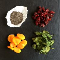 ingredient for chia fruit and greens bars on a. piece of slate