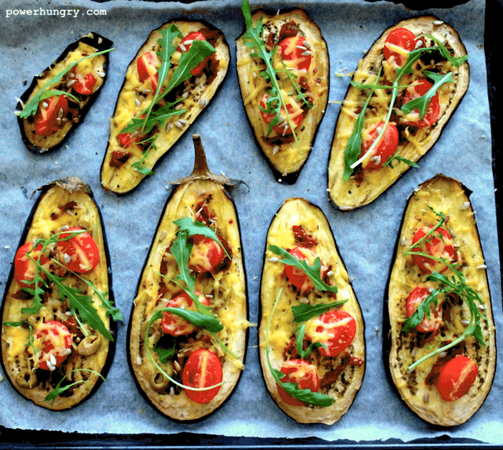 vegan eggplant pizza slices on a parchment paper lined baking sheet