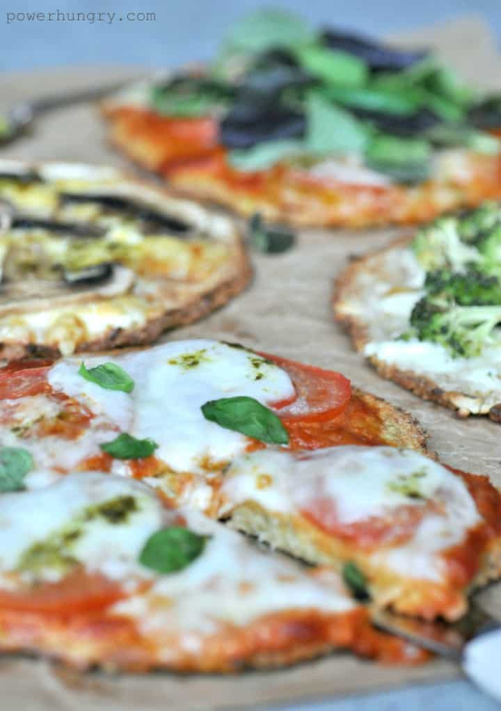 close up of vegan pizza crusts with toppings