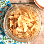 baked sweet salty coconut chips in a glass jar