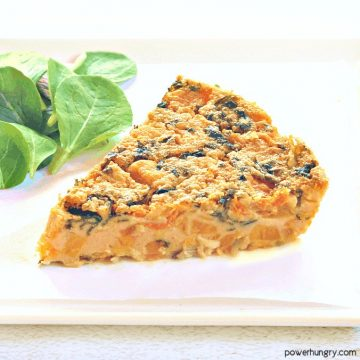 slice of sweet potato kale chickpea flour frittata on a white plate