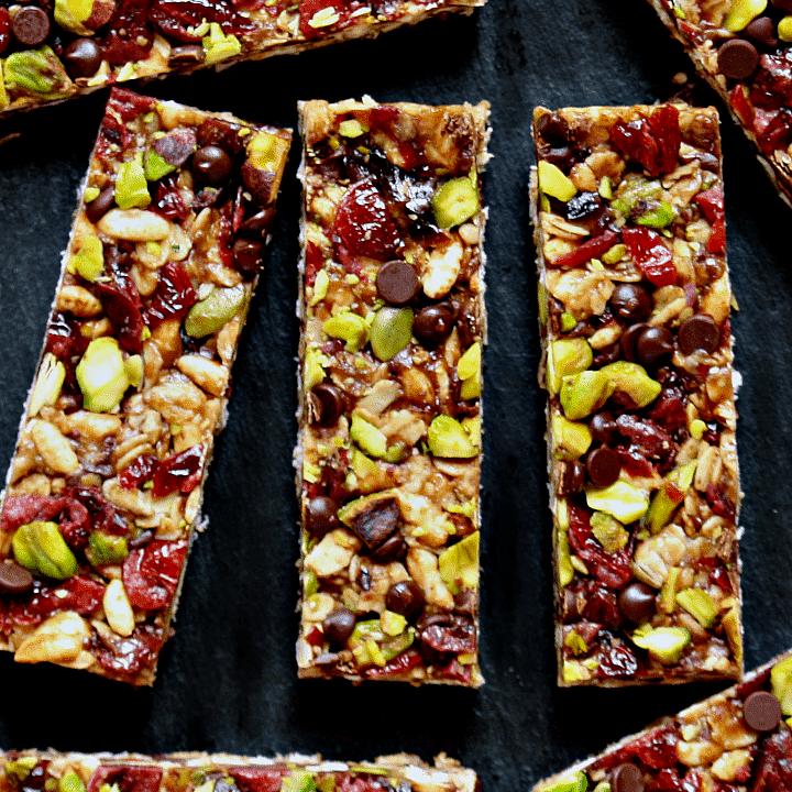 vegan no-bake trail mix bars on a piece of slate