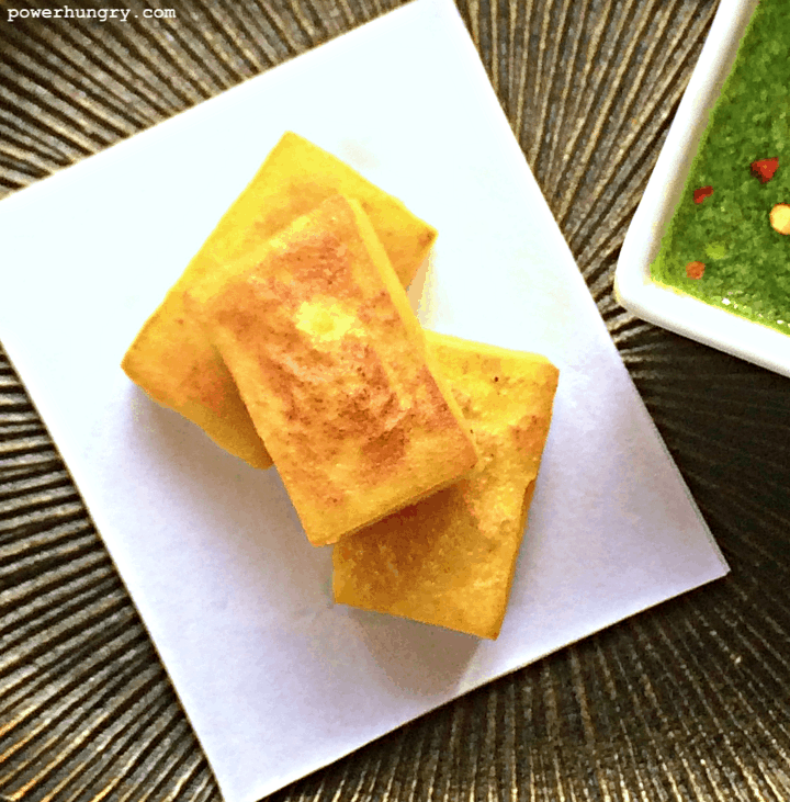 close-up of Burmese tofu (made with chickpea flour) on a grooved metal plate