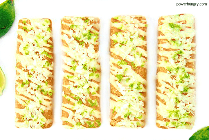 coconut lime protein bars on a white plate with some limes