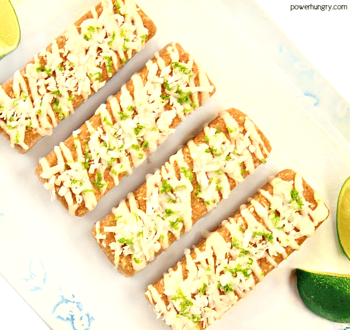 4-ingredient coconut lime almond protein bars on a white plate