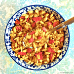 overhead shot of low calorie granola in a blue and white bowl