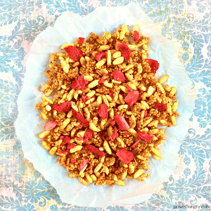 low cal granola made with puffed millet on a piece of white parchment paper